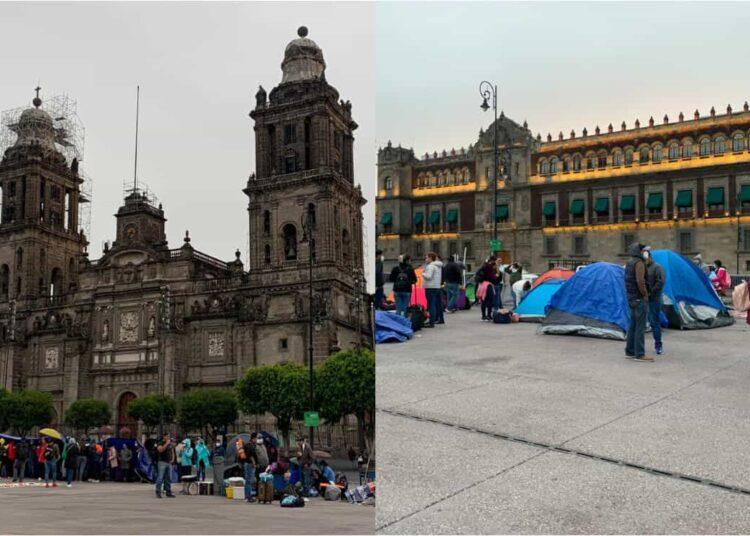 Con maletas, tanques de gas, mesas y sillas, algunos de los integrantes de la CNTE arriban para instalar un campamento permanente frente a Palacio Nacional.
