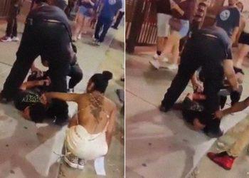 Testigos de una detención tratan de robarle la cadena a un hombre que esta inmovilizado por la policía