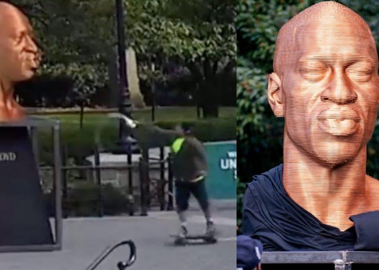 Un hombre en patineta arroja pintura a la estatua de George Floyd