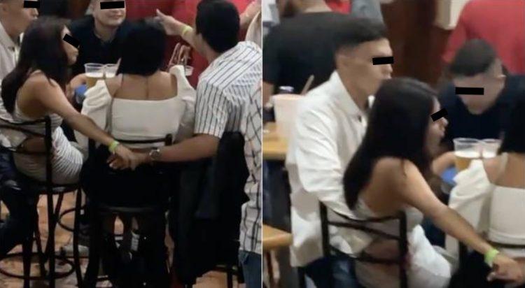 Dos 'amigos' fueron grabados acariciándose a espaldas de sus respectivas parejas; usuarios piden que la infidelidad se haga viral.